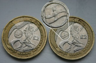 Commonwealth Games 2 pound coins for Northern Ireland and England compared